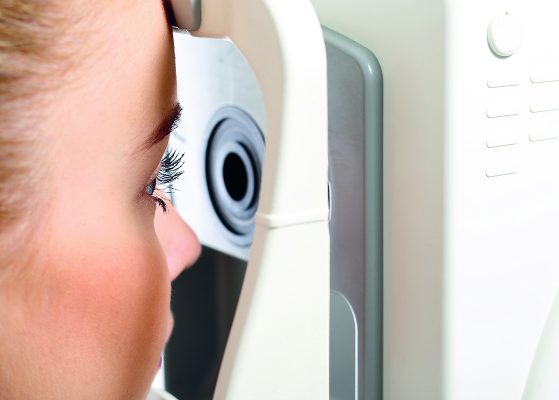 Computer vision test.The patient during an eye examination at the eye clinic ; Shutterstock ID 320017853