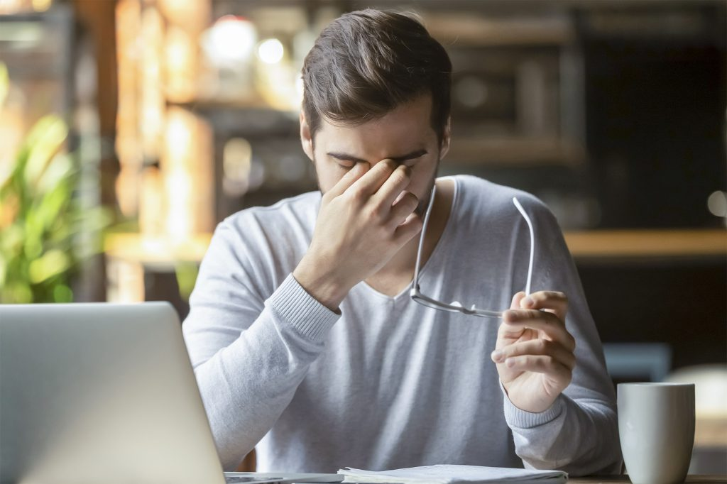 Frustrated businessman holding glasses feel eye strain, stressed overworked man massage nose bridge feel headache having bad blurry vision weak sight macular problem suffer from computer work syndrome; Shutterstock ID 1492614209; Auftragsnummer: -