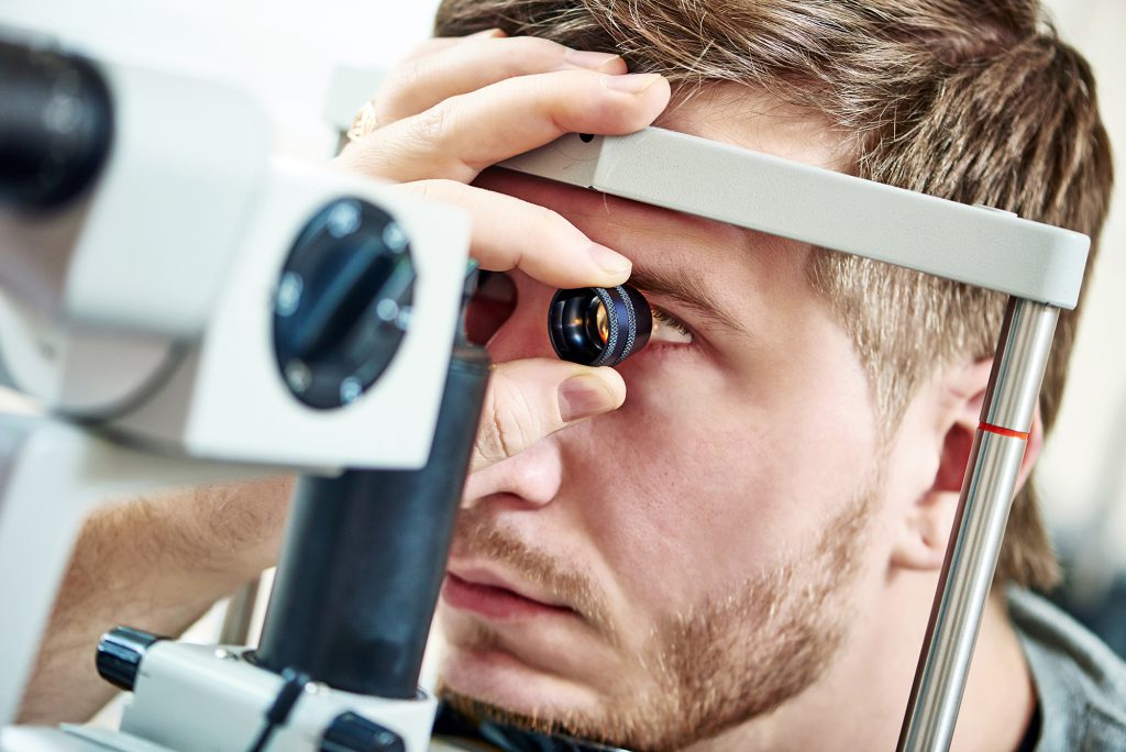 Ophthalmology concept. Male patient under eye vision examination in eyesight ophthalmological correction clinic ; Shutterstock ID 261198227
